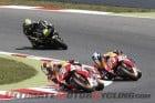 Repsol Honda's Dani Pedrosa leads teammate Marc Marquez and Monster Tech 3 Yamaha's Cal Crutchlow
