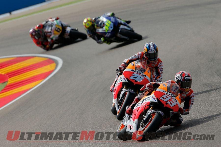 Repsol Honda's Marc Marquez leads Dani Pedrosa at Aragon
