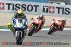 Yamaha's Valentino Rossi leads Repsol Honda's Dani Pedrosa and teammate Marc Marquez, the 2013 MotoGP Champion