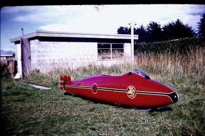 Burt Munro Indian streamliner outside his garage
